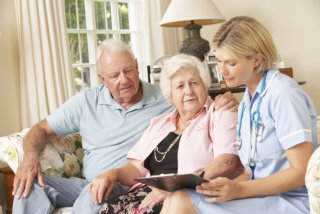 portrait of senior couple and caregiver