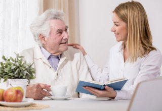 caregiver and old man having a conversation