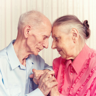 portrait of senior couple facing each other